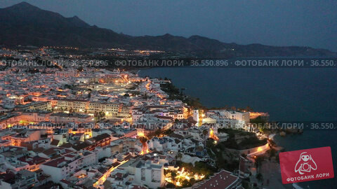 Aerial view of Nerja city with coastline in province of Malaga at night, Andalusia, southern Spain. Стоковое видео, видеограф Яков Филимонов / Фотобанк Лори