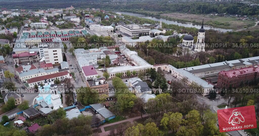 Aerial view of Orthodox Holy Trinity Cathedral on background with modern cityscape of Russian town of Kaluga in cloudy spring day. Стоковое видео, видеограф Яков Филимонов / Фотобанк Лори