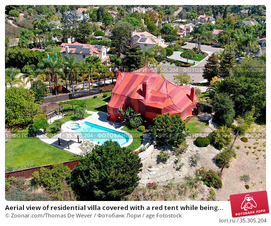 Aerial view of residential villa covered with a red tent while being... Стоковое фото, фотограф Zoonar.com/Thomas De Wever / age Fotostock / Фотобанк Лори