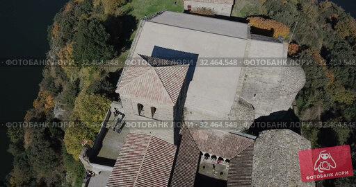 Купить «Aerial view of Sant Pere de Casserres - Benedictine monastery in Spain», видеоролик № 32464548, снято 17 ноября 2018 г. (c) Яков Филимонов / Фотобанк Лори