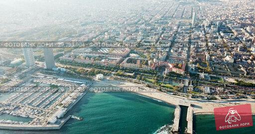 Купить «Aerial view of seaside area of Barcelona with harbor on sunny day, Catalonia, Spain», видеоролик № 29793904, снято 16 ноября 2018 г. (c) Яков Филимонов / Фотобанк Лори