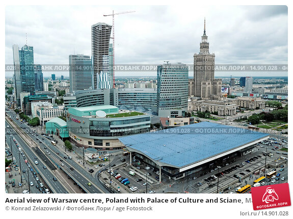 Купить «Aerial view of Warsaw centre, Poland with Palace of Culture and Sciane, Main Railway Station, Zlota 44 building, Golden Terraces shopping mall and Rondo 1 office building.», фото № 14901028, снято 17 мая 2012 г. (c) age Fotostock / Фотобанк Лори