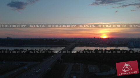 Купить «Aerial view to bridge, beauty sunset summer sky, Barnaul city, Siberia, Russia», видеоролик № 34126476, снято 7 июня 2020 г. (c) Jan Jack Russo Media / Фотобанк Лори
