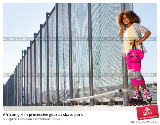 Купить «African girl in protective gear at skate park», фото № 27855532, снято 14 октября 2017 г. (c) Сергей Новиков / Фотобанк Лори
