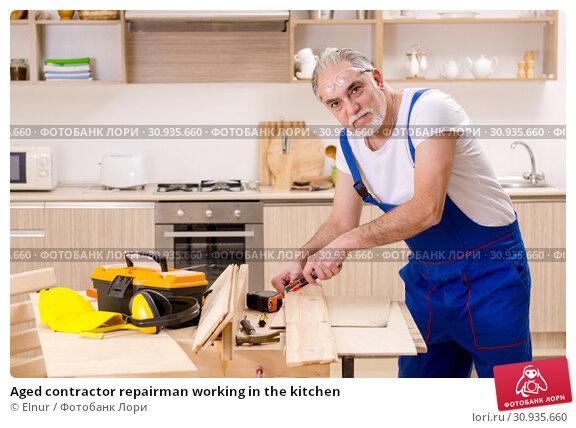 Купить «Aged contractor repairman working in the kitchen», фото № 30935660, снято 20 декабря 2018 г. (c) Elnur / Фотобанк Лори