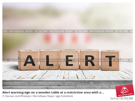 Alert warning sign on a wooden table at a restriction area with a... Стоковое фото, фотограф Zoonar.com/Polarpx / age Fotostock / Фотобанк Лори