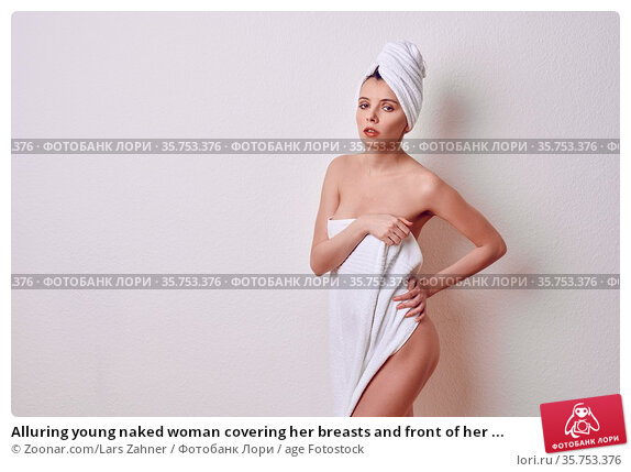Alluring young naked woman covering her breasts and front of her ... Стоковое фото, фотограф Zoonar.com/Lars Zahner / age Fotostock / Фотобанк Лори