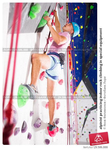 Купить «alpinist practicing indoor rock climbing in special equipment», фото № 29586888, снято 22 января 2019 г. (c) Яков Филимонов / Фотобанк Лори
