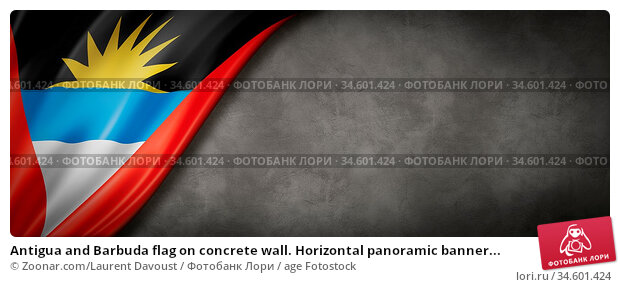 Antigua and Barbuda flag on concrete wall. Horizontal panoramic banner... Стоковое фото, фотограф Zoonar.com/Laurent Davoust / age Fotostock / Фотобанк Лори
