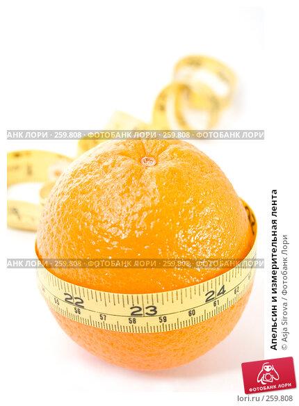 Апельсин и измерительная лента, фото № 259808, снято 19 апреля 2008 г. (c) Asja Sirova / Фотобанк Лори