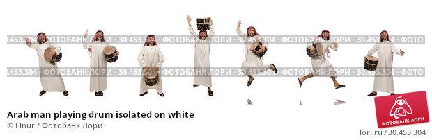 Arab man playing drum isolated on white. Стоковое фото, фотограф Elnur / Фотобанк Лори