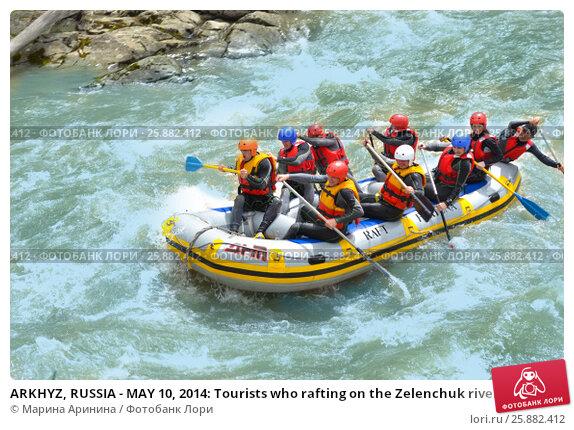 Купить «ARKHYZ, RUSSIA - MAY 10, 2014: Tourists who rafting on the Zelenchuk river», фото № 25882412, снято 10 мая 2014 г. (c) Ирина Аринина / Фотобанк Лори