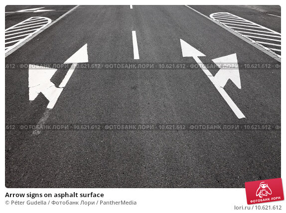 Arrow signs on asphalt surface. Стоковое фото, фотограф Péter Gudella / PantherMedia / Фотобанк Лори