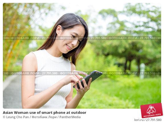 Купить «Asian Woman use of smart phone at outdoor», фото № 27791580, снято 20 февраля 2018 г. (c) PantherMedia / Фотобанк Лори