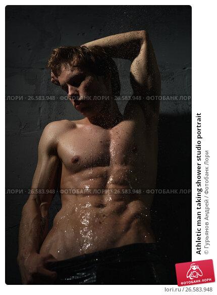 Купить «Athletic man taking shower studio portrait», фото № 26583948, снято 26 мая 2017 г. (c) Гурьянов Андрей / Фотобанк Лори