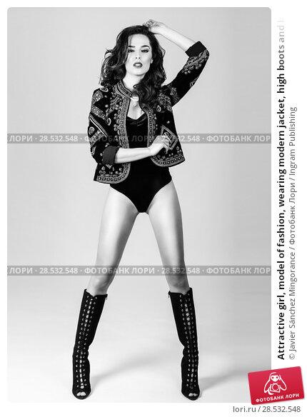 Купить «Attractive girl, model of fashion, wearing modern jacket, high boots and black lingerie. Female with long wavy hairstyle. Studio Shot.», фото № 28532548, снято 11 марта 2017 г. (c) Ingram Publishing / Фотобанк Лори