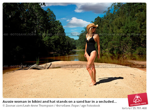 Aussie woman in bikini and hat stands on a sand bar in a secluded... Стоковое фото, фотограф Zoonar.com/Leah-Anne Thompson / age Fotostock / Фотобанк Лори
