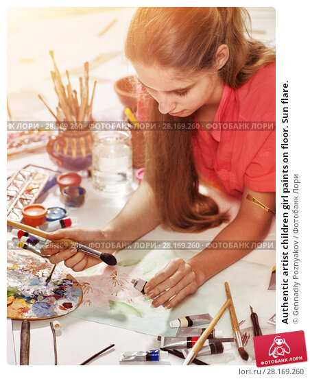 Купить «Authentic artist children girl paints on floor. Sun flare.», фото № 28169260, снято 21 января 2018 г. (c) Gennadiy Poznyakov / Фотобанк Лори