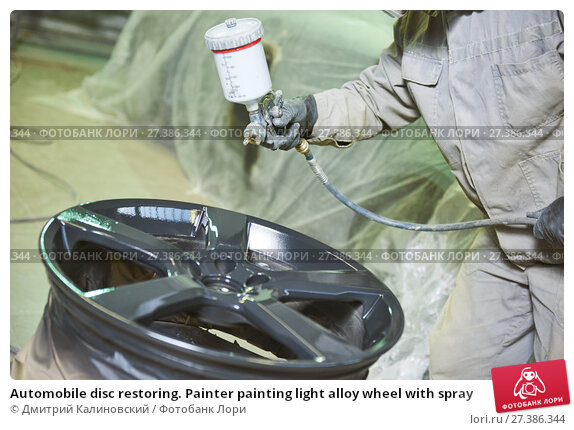 Купить «Automobile disc restoring. Painter painting light alloy wheel with spray», фото № 27386344, снято 28 марта 2017 г. (c) Дмитрий Калиновский / Фотобанк Лори