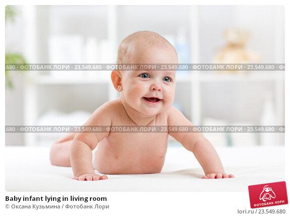 Купить «Baby infant lying in living room», фото № 23549680, снято 7 октября 2015 г. (c) Оксана Кузьмина / Фотобанк Лори