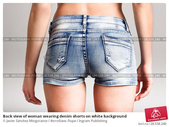 Купить «Back view of woman wearing denim shorts on white background», фото № 28538240, снято 12 января 2016 г. (c) Ingram Publishing / Фотобанк Лори