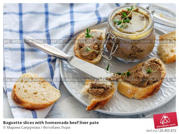 Купить «Baguette slices with homemade beef liver pate», фото № 28455872, снято 27 апреля 2018 г. (c) Марина Сапрунова / Фотобанк Лори
