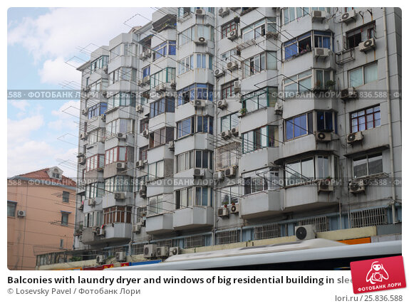 Balconies with laundry dryer and windows of big residential building in sleeping area, фото № 25836588, снято 7 ноября 2015 г. (c) Losevsky Pavel / Фотобанк Лори