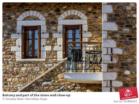 Купить «Balcony and part of the stone wall close-up», фото № 33804612, снято 12 марта 2020 г. (c) Татьяна Ляпи / Фотобанк Лори