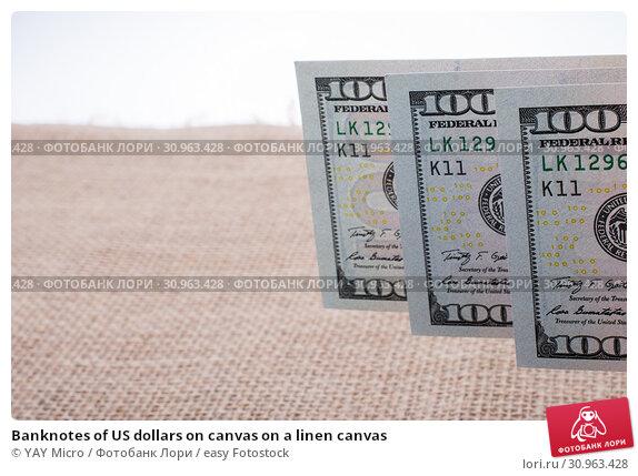 Купить «Banknotes of US dollars on canvas on a linen canvas», фото № 30963428, снято 6 апреля 2017 г. (c) easy Fotostock / Фотобанк Лори