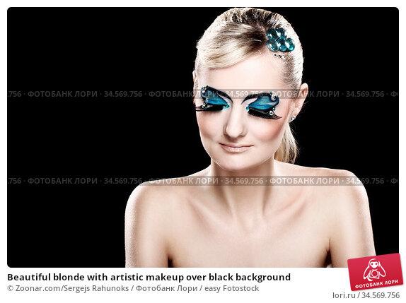 Beautiful blonde with artistic makeup over black background. Стоковое фото, фотограф Zoonar.com/Sergejs Rahunoks / easy Fotostock / Фотобанк Лори