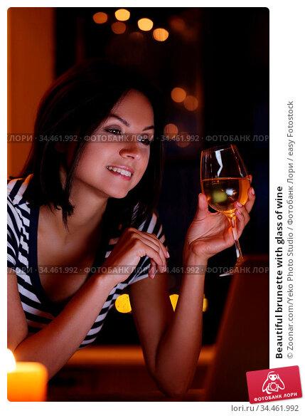 Beautiful brunette with glass of wine. Стоковое фото, фотограф Zoonar.com/Yeko Photo Studio / easy Fotostock / Фотобанк Лори