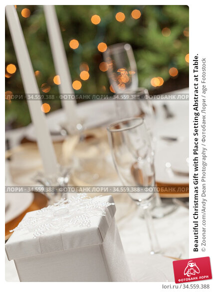 Beautiful Christmas Gift with Place Setting Abstract at Table. Стоковое фото, фотограф Zoonar.com/Andy Dean Photography / age Fotostock / Фотобанк Лори