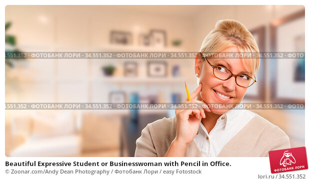 Beautiful Expressive Student or Businesswoman with Pencil in Office. Стоковое фото, фотограф Zoonar.com/Andy Dean Photography / easy Fotostock / Фотобанк Лори