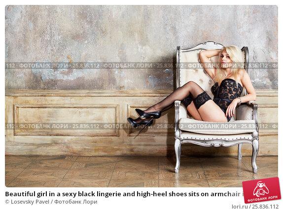 Купить «Beautiful girl in a sexy black lingerie and high-heel shoes sits on armchair in empty room», фото № 25836112, снято 17 сентября 2015 г. (c) Losevsky Pavel / Фотобанк Лори