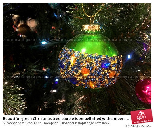 Beautiful green Christmas tree bauble is embellished with amber, ... Стоковое фото, фотограф Zoonar.com/Leah-Anne Thompson / age Fotostock / Фотобанк Лори