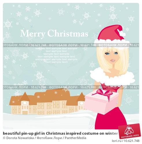 beautiful pin-up girl in Christmas inspired costume on winter landscape. Стоковое фото, фотограф Dorota Nowańska / PantherMedia / Фотобанк Лори