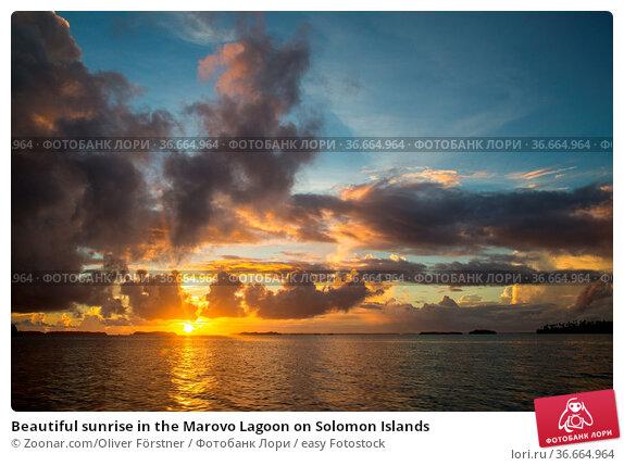 Beautiful sunrise in the Marovo Lagoon on Solomon Islands. Стоковое фото, фотограф Zoonar.com/Oliver Förstner / easy Fotostock / Фотобанк Лори
