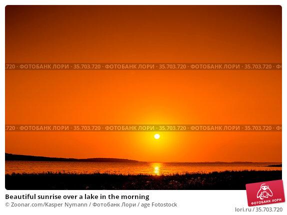 Beautiful sunrise over a lake in the morning. Стоковое фото, фотограф Zoonar.com/Kasper Nymann / age Fotostock / Фотобанк Лори