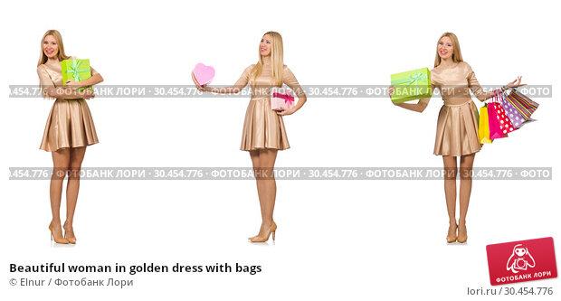 Beautiful woman in golden dress with bags. Стоковое фото, фотограф Elnur / Фотобанк Лори