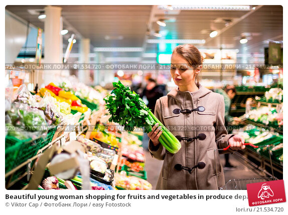 Купить «Beautiful young woman shopping for fruits and vegetables in produce department of a grocery store/supermarket», фото № 21534720, снято 22 апреля 2013 г. (c) easy Fotostock / Фотобанк Лори