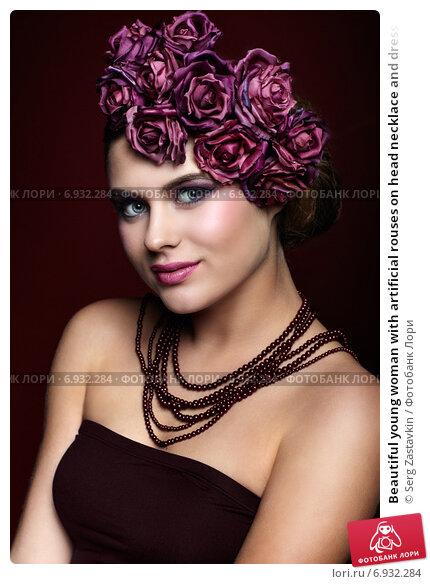 Купить «Beautiful young woman with artificial rouses on head necklace and dress on red marsala color background», фото № 6932284, снято 25 января 2015 г. (c) Serg Zastavkin / Фотобанк Лори