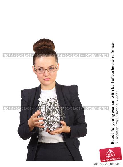 Купить «Beautiful young woman with ball of barbed wire fence», фото № 20408608, снято 7 июня 2014 г. (c) Losevsky Pavel / Фотобанк Лори