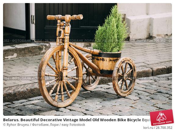 Купить «Belarus. Beautiful Decorative Vintage Model Old Wooden Bike Bicycle Equipped Basket In Street.», фото № 28700352, снято 2 июля 2016 г. (c) easy Fotostock / Фотобанк Лори
