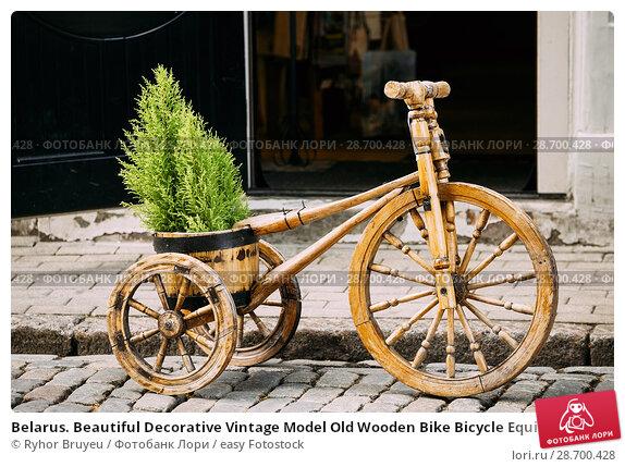 Купить «Belarus. Beautiful Decorative Vintage Model Old Wooden Bike Bicycle Equipped Basket In Street.», фото № 28700428, снято 2 июля 2016 г. (c) easy Fotostock / Фотобанк Лори