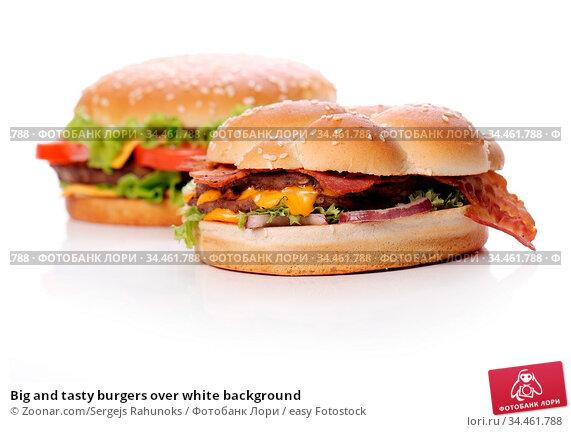 Big and tasty burgers over white background. Стоковое фото, фотограф Zoonar.com/Sergejs Rahunoks / easy Fotostock / Фотобанк Лори