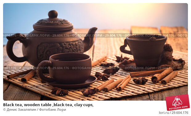 Купить «Black tea, wooden table ,black tea, clay cups,», фото № 29604176, снято 21 апреля 2019 г. (c) Денис Закаляпин / Фотобанк Лори