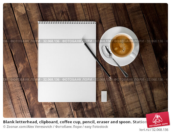 Blank letterhead, clipboard, coffee cup, pencil, eraser and spoon. Stationery template on wooden background. Mock up for placing your design. Flat lay. Стоковое фото, фотограф Zoonar.com/Alex Veresovich / easy Fotostock / Фотобанк Лори