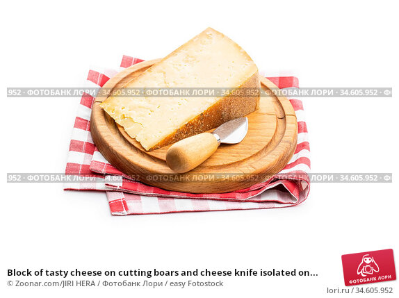 Block of tasty cheese on cutting boars and cheese knife isolated on... Стоковое фото, фотограф Zoonar.com/JIRI HERA / easy Fotostock / Фотобанк Лори