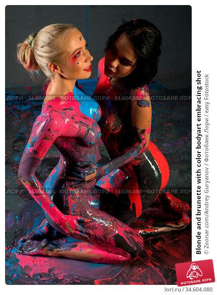Blonde and brunette with color bodyart embracing shot. Стоковое фото, фотограф Zoonar.com/Andrey Guryanov / easy Fotostock / Фотобанк Лори