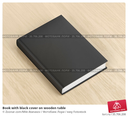 Book with black cover on wooden table. Стоковое фото, фотограф Zoonar.com/Mile Atanasov / easy Fotostock / Фотобанк Лори